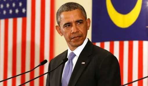 U.S. President Obama listens to Malaysian PM Razak as they participate in joint news conference in Malaysia